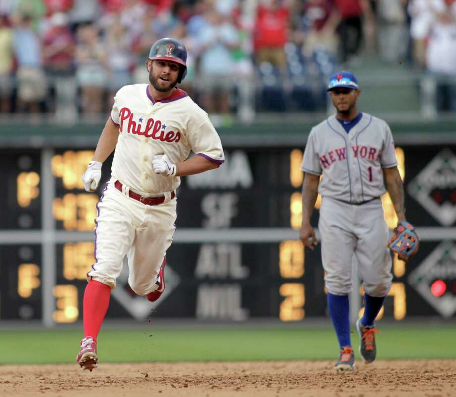 Philadelphia Phillies'  Kevin Frandsen runs the bases after he hit a solo home run against the New York Mets in the ninth inning of a baseball game Saturday, June 22, 2013, in Philadelphia. The Phillies won 8-7.  (AP Photo/H. Rumph Jr) Photo: H. RUMPH JR