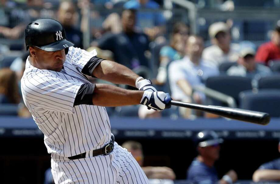 New York Yankees' Vernon Wells hits a ground-rule double to drive in three runs during the seventh inning of a baseball game against the Tampa Bay Rays Saturday, June 22, 2013, in New York. (AP Photo/Frank Franklin II) Photo: Frank Franklin II