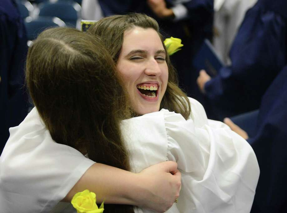 Andrea Jelaska, right, and Shana Simonson share a hug after the 2013 Brookfield High School commencement ceremony at the O'Neill Center in Danbury, Conn. on Saturday, June 22, 2013. Photo: Tyler Sizemore / The News-Times