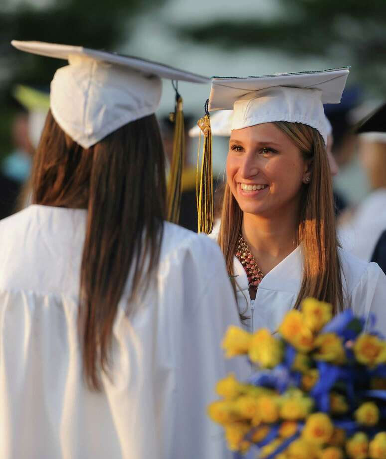 Jenna Bellano gets ready for the 2013 Brookfield High School commencement ceremony at the O'Neill Center in Danbury, Conn. on Saturday, June 22, 2013. Photo: Tyler Sizemore / The News-Times
