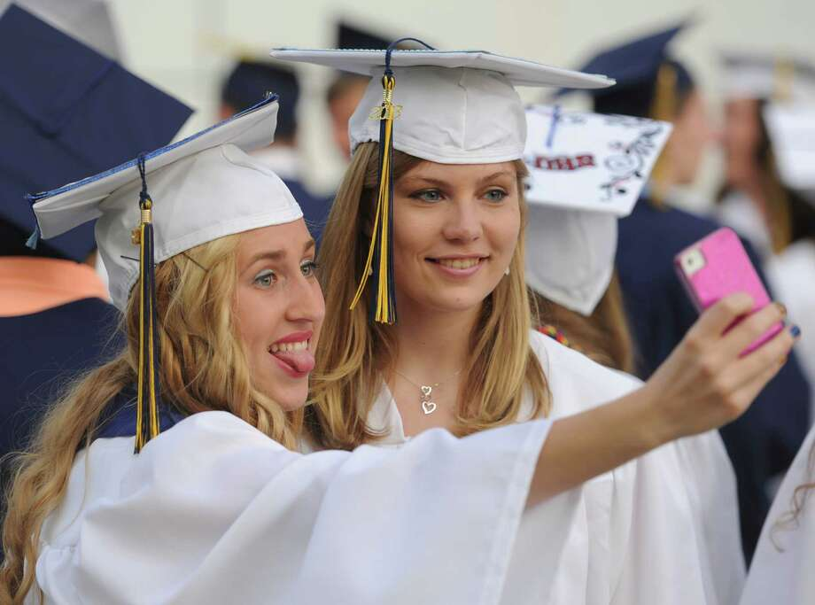 "Lauren Wrubel, left, and Victoria Zenevitch take a ""selfie"" before the 2013 Brookfield High School commencement ceremony at the O'Neill Center in Danbury, Conn. on Saturday, June 22, 2013. Photo: Tyler Sizemore / The News-Times"