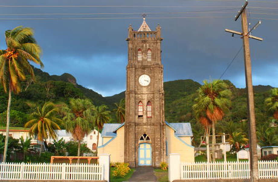 Levuka, primarily a low line of buildings set among coconut and mango trees along the beach front, was the first colonial capital of Fiji, ceded to the British in 1874.