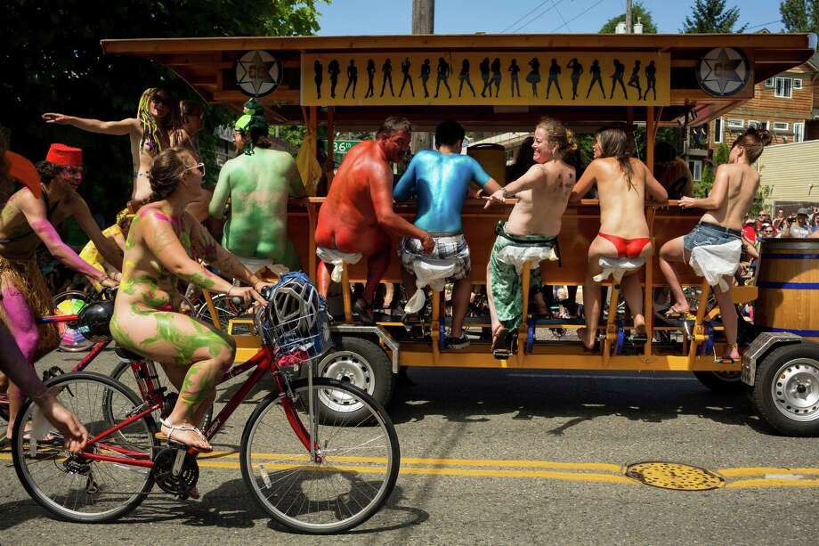 Naked bicyclists take to the streets. Photo: JORDAN STEAD, SEATTLEPI.COM / SEATTLEPI.COM