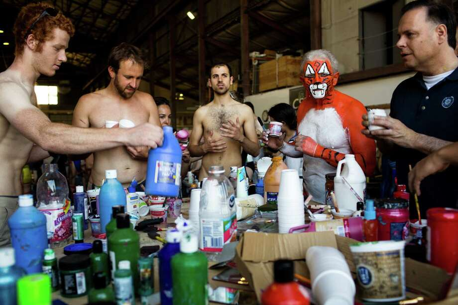 Naked bicycle riders prep at a paint party. Photo: JORDAN STEAD, SEATTLEPI.COM / SEATTLEPI.COM
