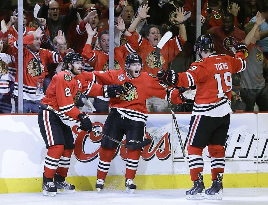 Chicago Blackhawks defenseman Patrick Kane (88), center,  celebrates with center Jonathan Toews (19) and defenseman Duncan Keith (2) after scoring a goal against the Boston Bruins in the second period during Game 5 of the NHL hockey Stanley Cup Finals, Saturday, June 22, 2013, in Chicago. (AP Photo/Nam Y. Huh) Photo: Nam Y. Huh, Associated Press