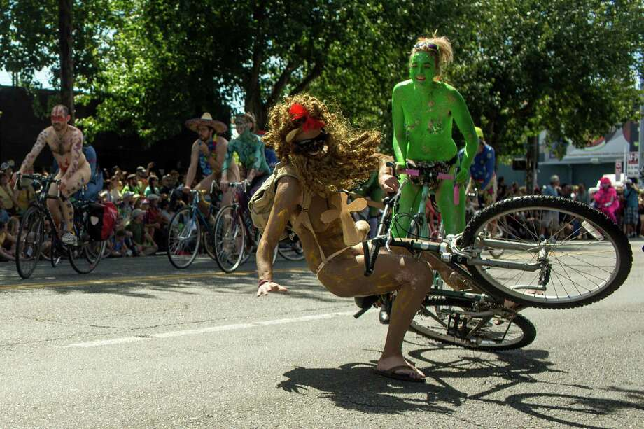 A naked bicyclist takes a fall. Photo: JORDAN STEAD, SEATTLEPI.COM / SEATTLEPI.COM