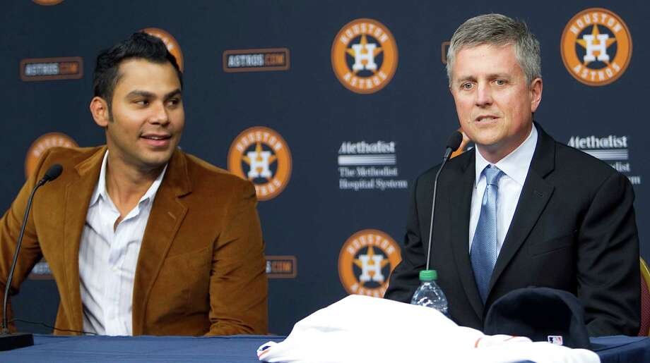 Carlos Pena left, looks on as Houston Astros General Manager Jeff Luhnow speaks during a press conference announcing Pena's signing of a one-year contract with the Houston Astros at Minute Maid Park Monday, Dec. 17, 2012, in Houston.   ( James Nielsen / Chronicle ) Photo: James Nielsen, Staff / © Houston Chronicle 2012
