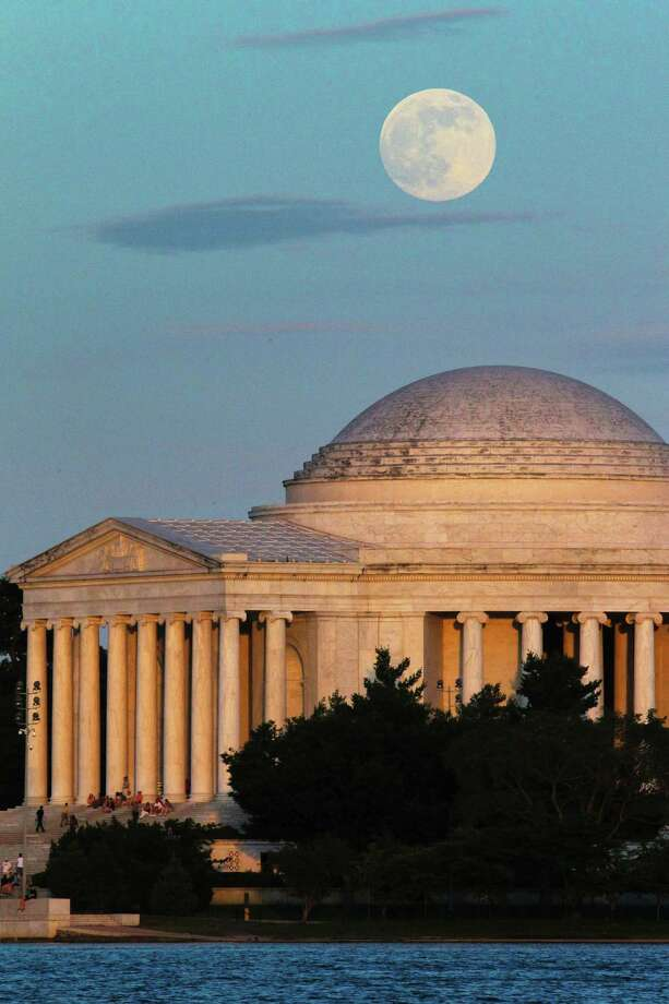 "A full moon rises behind the Jefferson Memorial in Washington Saturday, June 22, 2013. The larger than normal moon called the ""Supermoon"" happens only once this year as the moon on its elliptical orbit is at its closest point to earth. (AP Photo/J. David Ake) Photo: J. David Ake, Associated Press / AP"