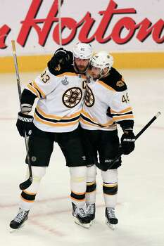 CHICAGO, IL - JUNE 22:  Zdeno Chara #33 of the Boston Bruins celebrates with his teammates David Krejci #46 after Chara scored a goal in the third period against Corey Crawford #50 of the Chicago Blackhawks in Game Five of the 2013 NHL Stanley Cup Final at United Center on June 22, 2013 in Chicago, Illinois. Photo: Jamie Squire, Getty Images / 2013 Getty Images