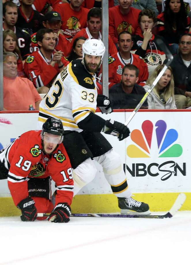 CHICAGO, IL - JUNE 22:  Jonathan Toews #19 of the Chicago Blackhawks falls to the ice against Zdeno Chara #33 of the Boston Bruins in Game Five of the 2013 NHL Stanley Cup Final at United Center on June 22, 2013 in Chicago, Illinois. Photo: Bruce Bennett, Getty Images / 2013 Getty Images