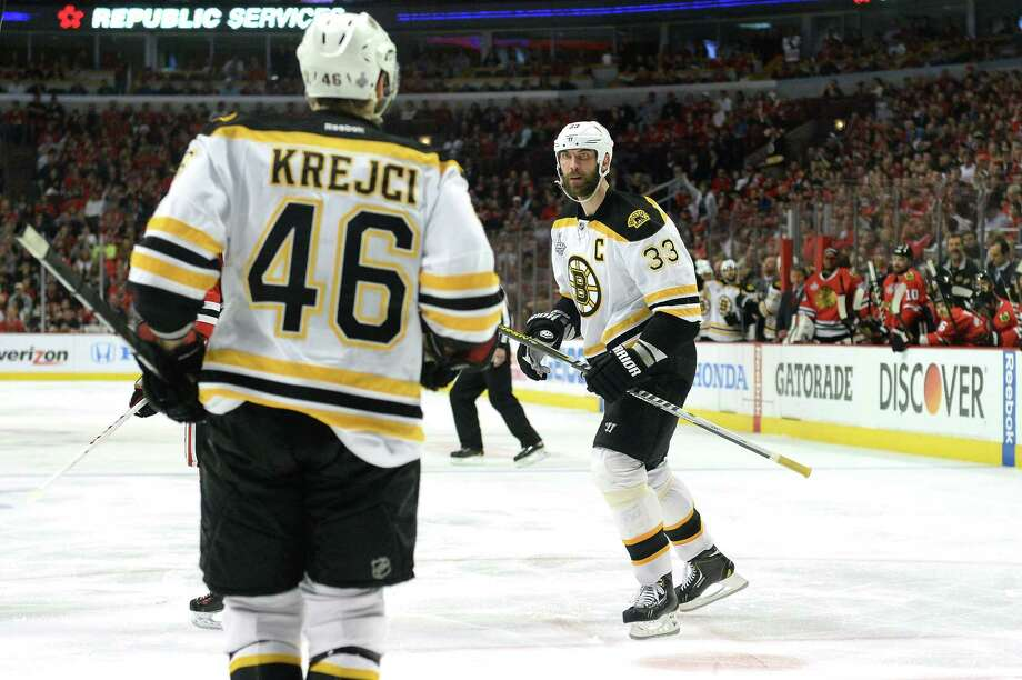 CHICAGO, IL - JUNE 22:  Zdeno Chara #33 and David Krejci #46 of the Boston Bruins celebrate after CHara scored a goal in the third period against the Chicago Blackhawks in Game Five of the 2013 NHL Stanley Cup Final at United Center on June 22, 2013 in Chicago, Illinois. Photo: Harry How, Getty Images / 2013 Getty Images