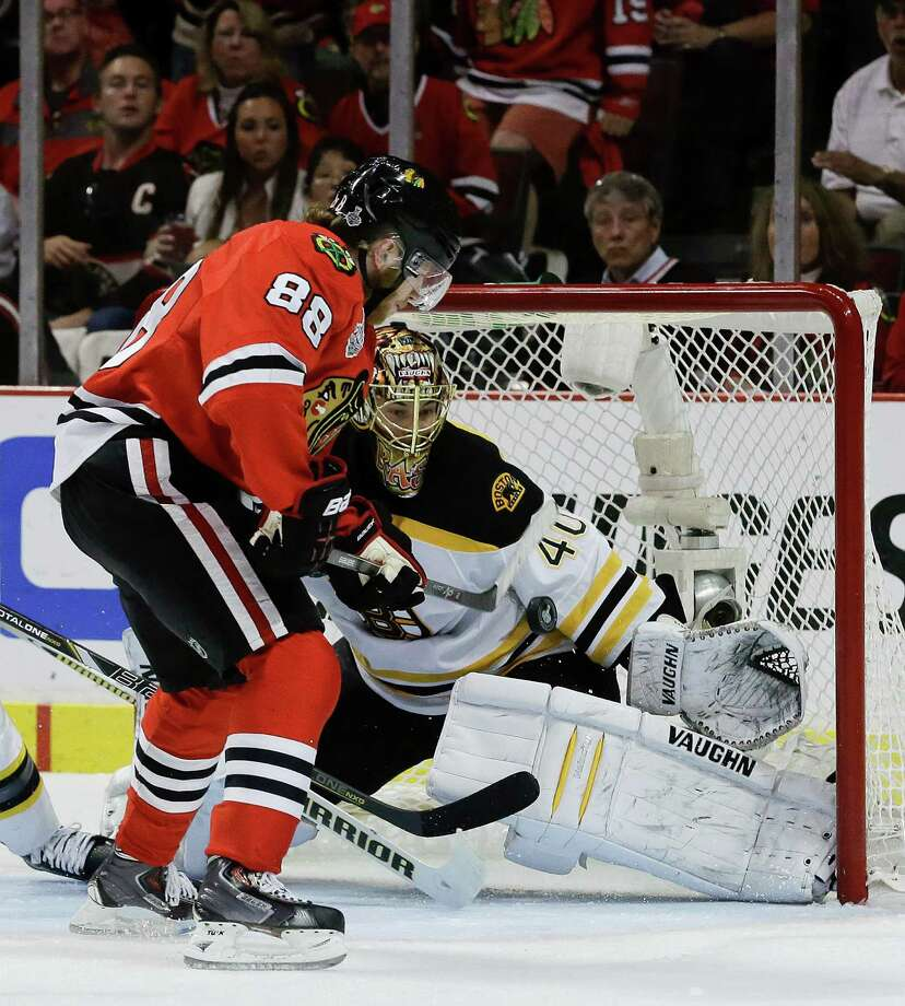 Chicago Blackhawks right wing Patrick Kane (88) scores against Boston Bruins goalie Tuukka Rask (40) in the second period during Game 5 of the NHL hockey Stanley Cup Finals, Saturday, June 22, 2013, in Chicago. (AP Photo/Nam Y. Huh) Photo: Nam Y. Huh, Associated Press / AP