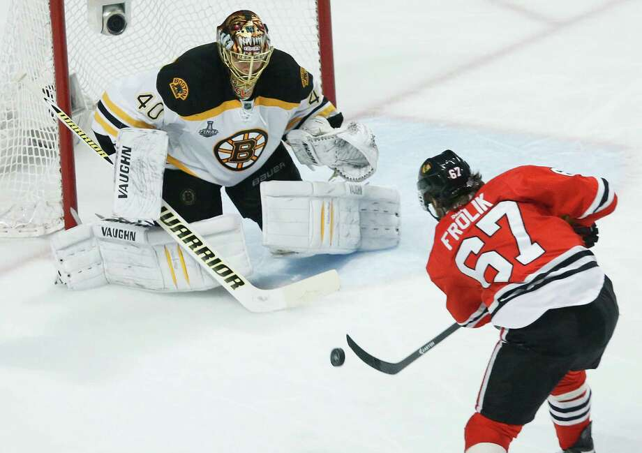 Chicago Blackhawks center Michael Frolik (67) shoots against Boston Bruins goalie Tuukka Rask (40) in the third period during Game 5 of the NHL hockey Stanley Cup Finals, Saturday, June 22, 2013, in Chicago. (AP Photo/Charles Rex Arbogast) Photo: Charles Rex Arbogast, Associated Press / AP