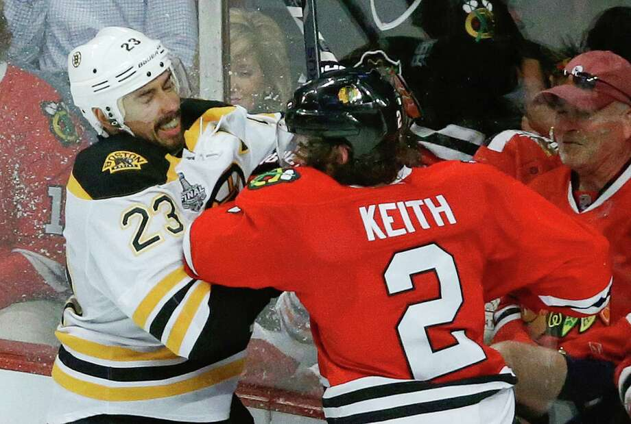 Game 5: Chicago 3, Boston 1Chicago leads best-of-seven series 3-2Boston Bruins center Chris Kelly (23) collides with Chicago Blackhawks defenseman Duncan Keith (2) in the third period during Game 5 of the NHL hockey Stanley Cup Finals, Saturday, June 22, 2013, in Chicago. (AP Photo/Charles Rex Arbogast) Photo: Charles Rex Arbogast, Associated Press / AP