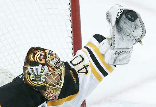 Boston Bruins goalie Tuukka Rask (40) gloves the puck against the Chicago Blackhawks during Game 5 of the NHL hockey Stanley Cup Finals, Saturday, June 22, 2013, in Chicago. (AP Photo/Charles Rex Arbogast) Photo: Charles Rex Arbogast, Associated Press / AP