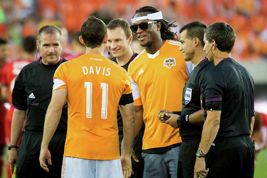 Houston Texans first-round draft pick WR DeAndre Hopkins, facing, greets Houston Dynamo midfielder Brad Davis (11) before a game against the Toronto FC on Saturday, June 22, 2013, at BBVA Compass Stadium in Houston.  Hopkins served as the Dynamo honorary captain for the game. Photo: Smiley N. Pool, Houston Chronicle / © 2013  Houston Chronicle