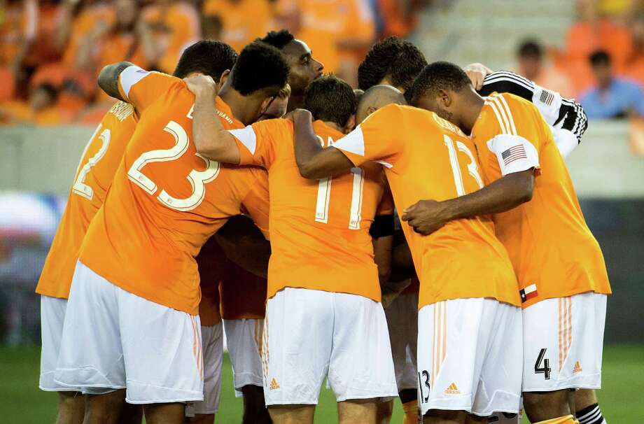 Houston Dynamo players huddle before facing the Toronto FC on Saturday, June 22, 2013, at BBVA Compass Stadium in Houston. Photo: Smiley N. Pool, Houston Chronicle / © 2013  Houston Chronicle