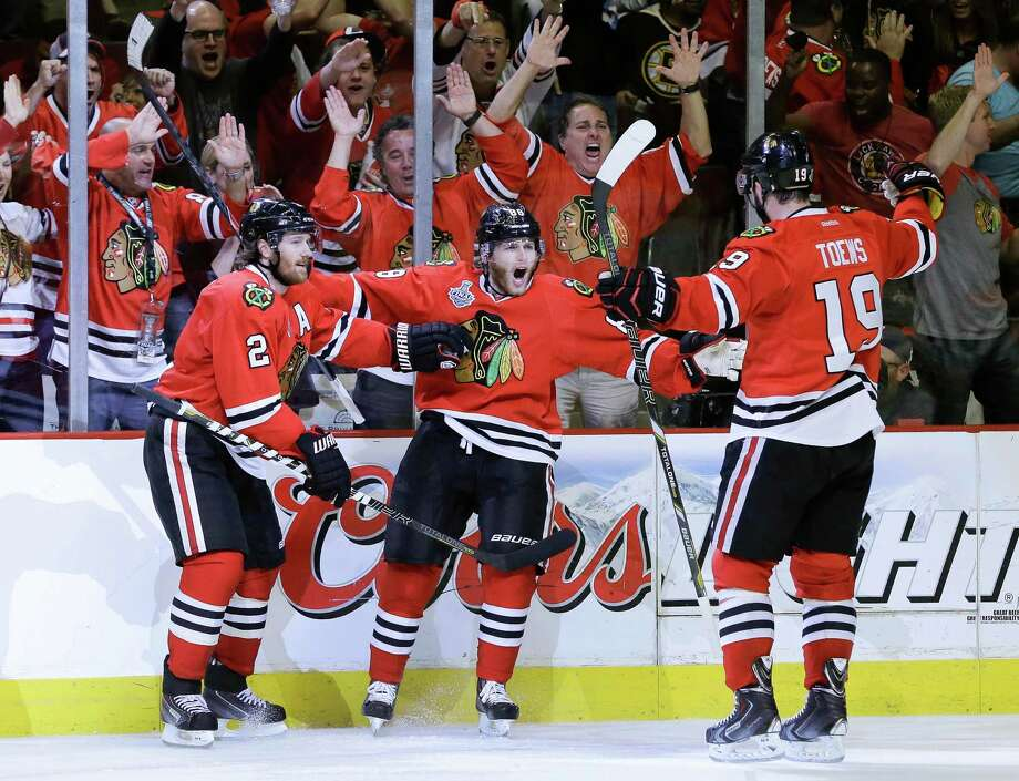 Chicago Blackhawks defenseman Nick Leddy (8) celebrates with center Jonathan Toews (19) and defenseman Duncan Keith (2) after scoring a goal against the Boston Bruins in the second period during Game 5 of the NHL hockey Stanley Cup Finals, Saturday, June 22, 2013, in Chicago. (AP Photo/Nam Y. Huh) Photo: Nam Y. Huh