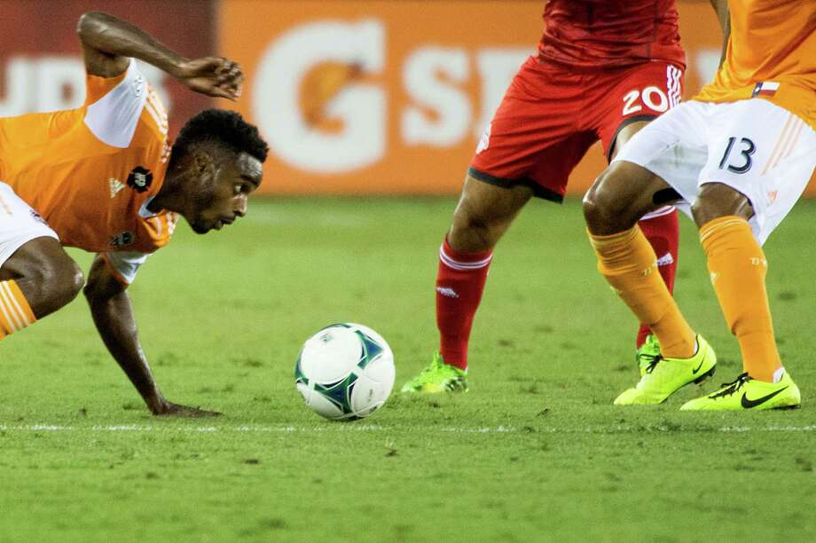 Houston Dynamo defender Warren Creavalle slips to the turf as he chase the ball during the first half against the Toronto FC on Saturday, June 22, 2013, at BBVA Compass Stadium in Houston. Photo: Smiley N. Pool, Houston Chronicle / © 2013  Houston Chronicle