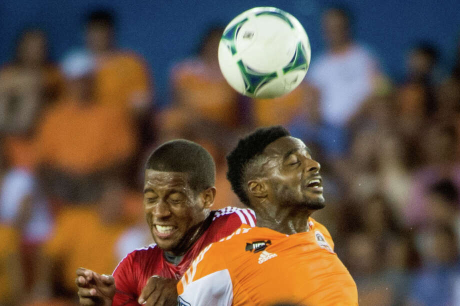 Houston Dynamo defender Warren Creavalle, right, and Toronto FC defender Jeremy Hall fight for a header during the first half on Saturday, June 22, 2013, at BBVA Compass Stadium in Houston. Photo: Smiley N. Pool, Houston Chronicle / © 2013  Houston Chronicle
