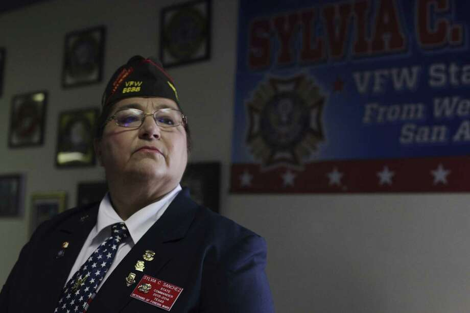 Sylvia Sanchez of San Antonio stands in front of a sign dedicated to her at VFW Post 8936 on the West Side. Sanchez was an Army nurse in the Persian Gulf War, and is the first woman elected statewide commander of the Veterans of Foreign Wars. Photo: Abbey Oldham / San Antonio Express-News