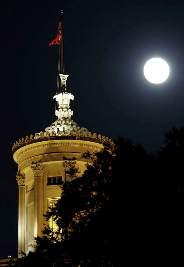 The moon rises behind the Tennessee state capitol on Saturday, June 22, 2013, in Nashville, Tenn. The biggest and brightest full moon of the year, called a supermoon, happens as the moon passes closer to earth than usual. (AP Photo/Mark Humphrey) Photo: Mark Humphrey, Associated Press / AP