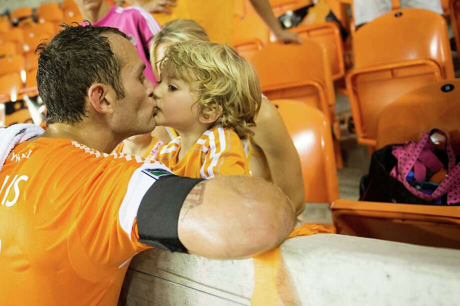 Houston Dynamo midfielder Brad Davis kisses his son Kaden after a scoreless draw against the Toronto FC on Saturday, June 22, 2013, at BBVA Compass Stadium in Houston. Photo: Smiley N. Pool, Houston Chronicle / © 2013  Houston Chronicle