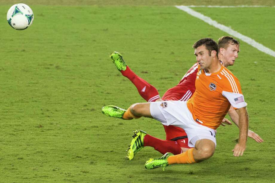 Houston Dynamo forward Will Bruin (12) collides with Toronto FC defender Steven Caldwell (13) during the second half on Saturday, June 22, 2013, at BBVA Compass Stadium in Houston. Photo: Smiley N. Pool, Houston Chronicle / © 2013  Houston Chronicle