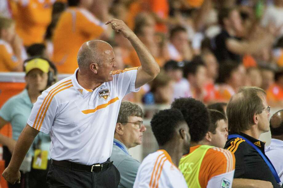 Houston Dynamo head coach Dominic Kinnear reacts to a call against his team during the second half against the Toronto FC on Saturday, June 22, 2013, at BBVA Compass Stadium in Houston. Photo: Smiley N. Pool, Houston Chronicle / © 2013  Houston Chronicle