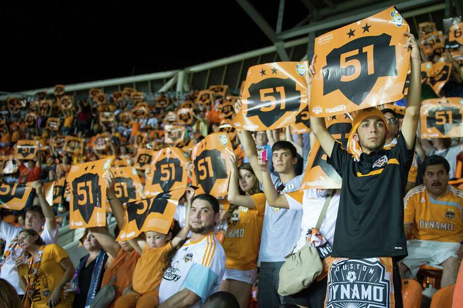 Houston Dynamo fans hold up signs in support of Houston Fire Department station #51 during the 51st minute of their game against the Toronto FC on Saturday, June 22, 2013, at BBVA Compass Stadium in Houston. The team honored the firefighters during the game in recognition of a five-alarm blaze on May 31 blaze left four Houston firefighters dead and 13 injured in was has been described as the deadliest in the history of the city's fire department. Photo: Smiley N. Pool, Houston Chronicle / © 2013  Houston Chronicle