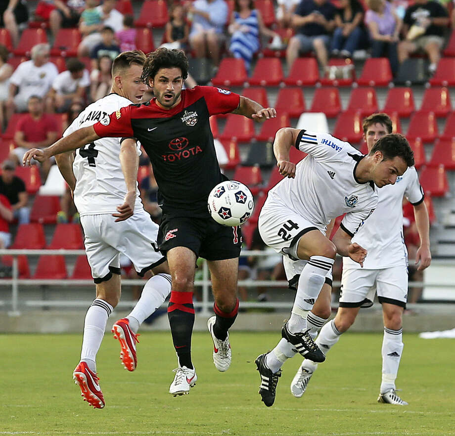 Blake Wagner of the Scorpions (center) breaks away from a crowd while helping his club to its fourth win in five NASL matches. Photo: Tom Reel / San Antonio Express-News