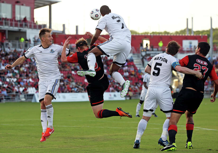 Patrick Phelan is foiled on a header attempt near the goal by Chris Nurse in the first half as the San Antonio Scorpions host FC Edmonton on June 22, 2013. Photo: For The San Antonio Express-News