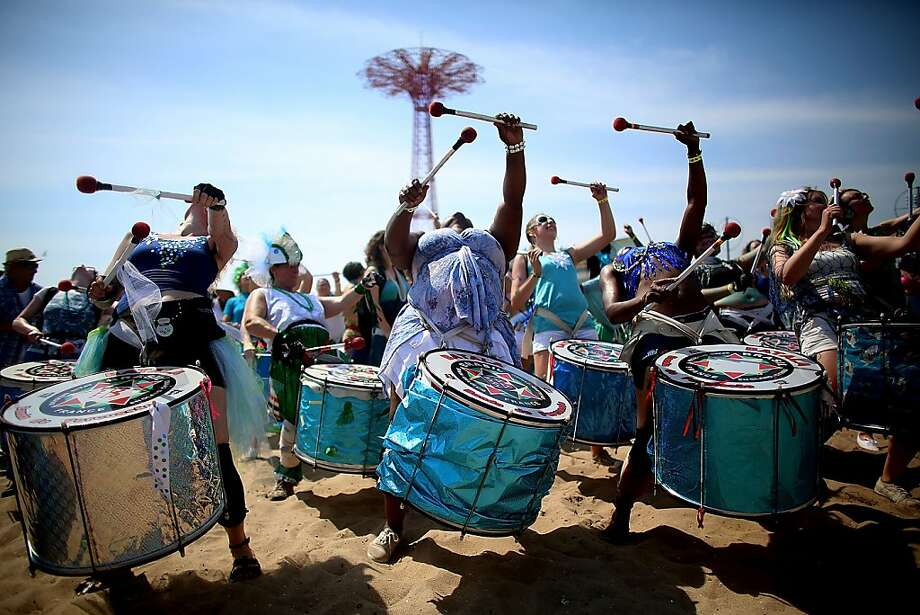 NEW YORK, NY - JUNE 22:  Musicians perform on the beach at the 2013 Mermaid Parade at Coney Island on June 22, 2013 in the Brooklyn borough of New York City. Coney Island was hard hit by Superstorm Sandy but parade organizers, whose offices were flooded, were able to raise $100,000 on Kickstarter to fund the parade. The Mermaid Parade began in 1983 and features participants dressed as mermaids and other sea creatures while paying homage to the former tradition of the Coney Island Mardi Gras which ran annually in the early fall from 1903-1954.  (Photo by Mario Tama/Getty Images) Photo: Mario Tama, Getty Images