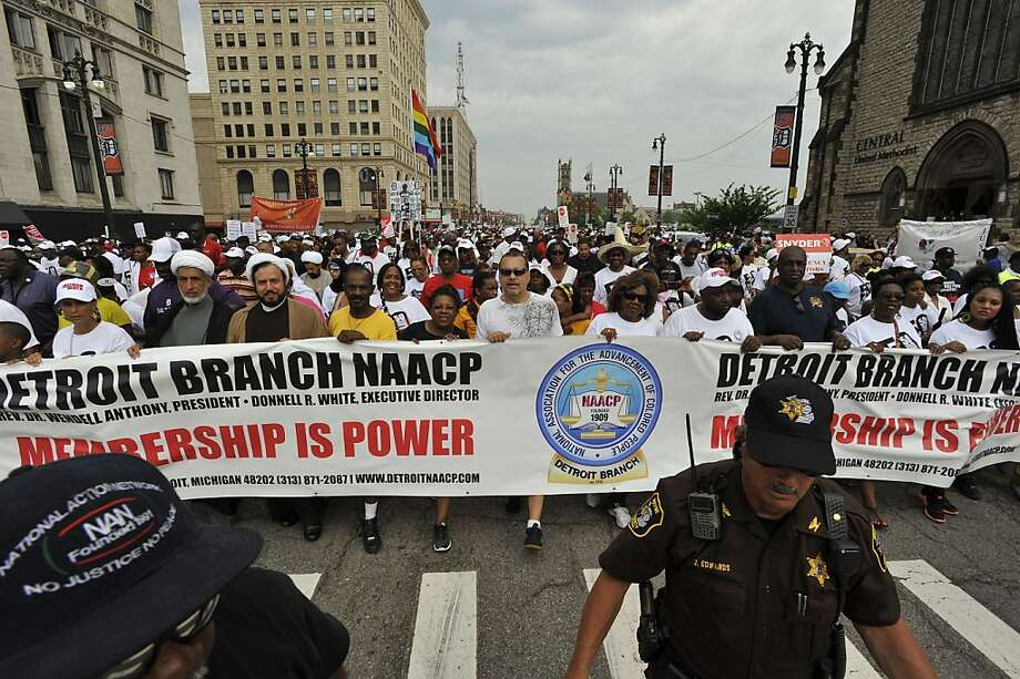 Dignitaries at the front of the Freedom Walk carry an NAACP banner as they march down Woodward Avenue to commemorate Martin Luther King Jr.'s historic march 50 years ago,  Saturday, June 22, 2013 in Detroit. (AP Photo/Detroit News, John T. Greilick)  Photo: John T. Greilick, Associated Press