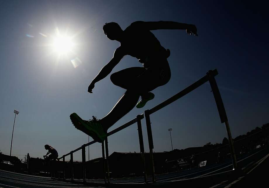 DES MOINES, IA - JUNE 22:  Dakotah Keys competes in the Men's 110 Meter Hurdles portion of the Decathlon on day three of the 2013 USA Outdoor Track & Field Championships at Drake Stadium on June 22, 2013 in Des Moines, Iowa.  (Photo by Christian Petersen/Getty Images) Photo: Christian Petersen, Getty Images