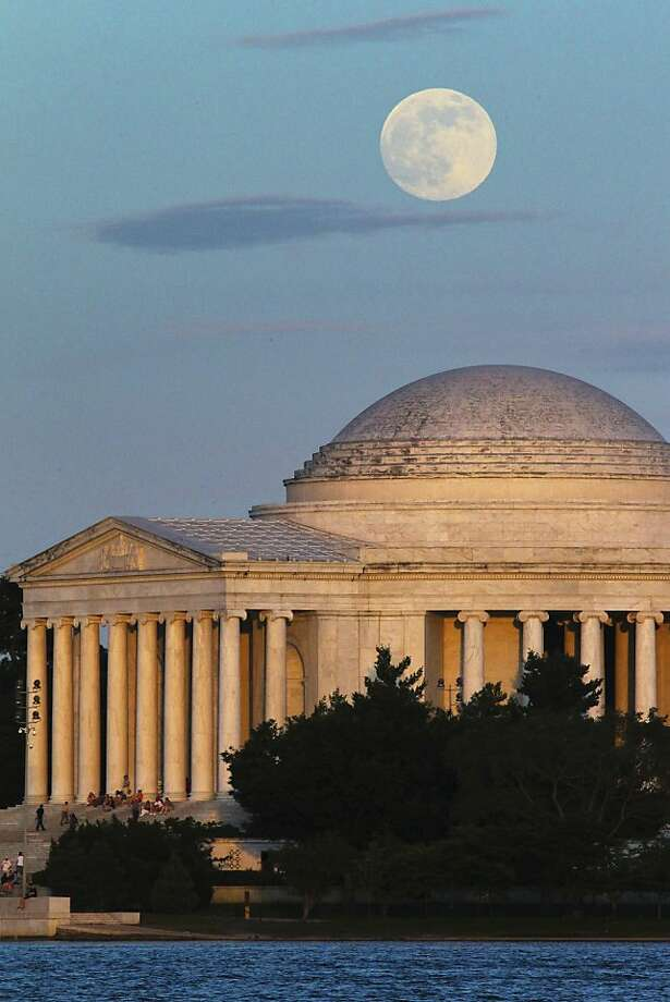 "A full moon rises behind the Jefferson Memorial in Washington Saturday, June 22, 2013. The larger than normal moon called the ""Supermoon"" happens only once this year as the moon on its elliptical orbit is at its closest point to earth. (AP Photo/J. David Ake) Photo: J. David Ake, Associated Press"