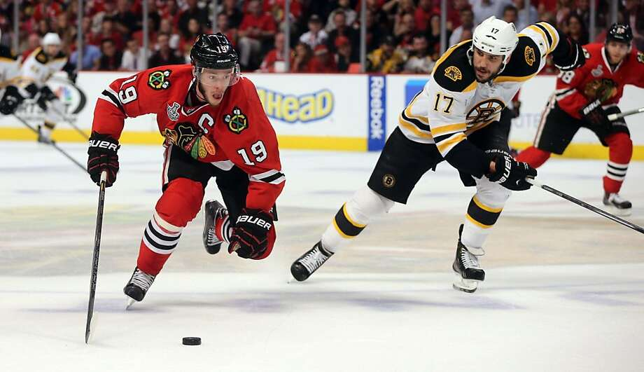 The Chicago Blackhawks' Jonathan Toews (19) carries the puck with an escort from the Boston Bruins' Milan Lucic (17) in Game 5 of the NHL Finals on Saturday, June 22, 2013, at the United Center in Chicago, Illinois. (Brian Cassella/Chicago Tribune/MCT) Photo: Brian Cassella, McClatchy-Tribune News Service