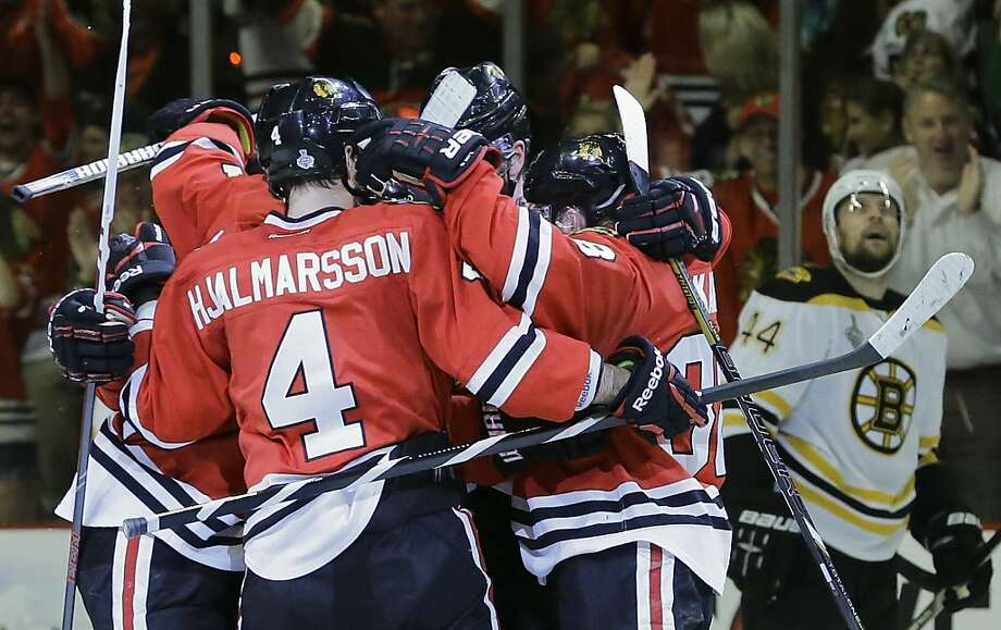 The Chicago Blackhawks celebrate a second period goal against the Boston Bruins during Game 5 of the NHL hockey Stanley Cup Finals, Saturday, June 22, 2013, in Chicago. (AP Photo/Nam Y. Huh) Photo: Nam Y. Huh, Associated Press