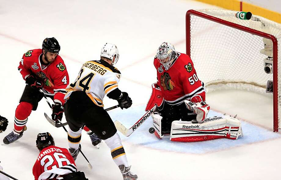 CHICAGO, IL - JUNE 22:  Corey Crawford #50 of the Chicago Blackhawks makes a save against the Boston Bruins in Game Five of the 2013 NHL Stanley Cup Final at United Center on June 22, 2013 in Chicago, Illinois.  (Photo by Jamie Squire/Getty Images) Photo: Jamie Squire, Getty Images