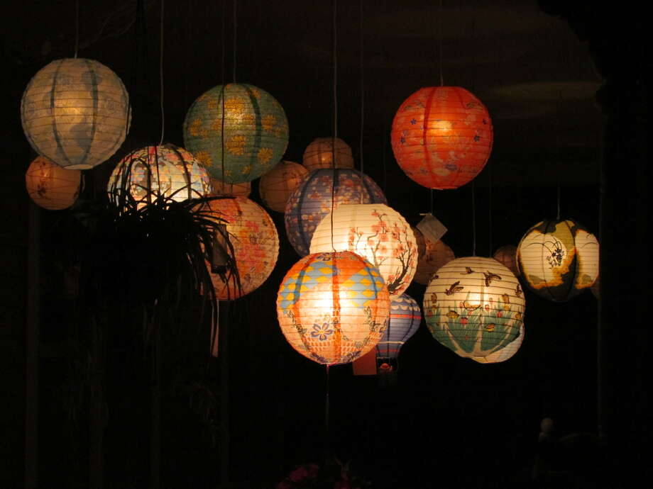 Houses are decorated with lanterns in Round Lake during the Night of Illumination, June 22, 2013. Photo: Paul Block