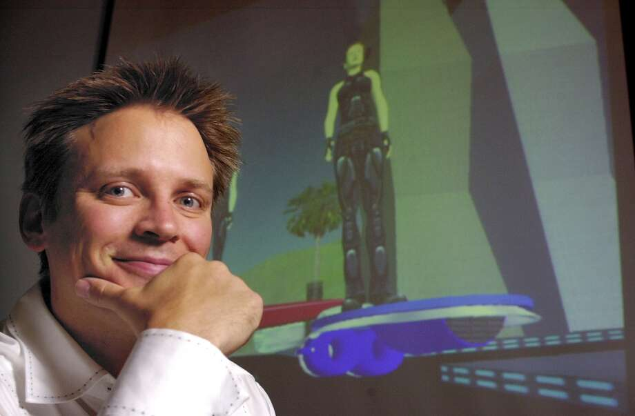 "CEO Philip Rosedale in front of a projection of the new game by Linden Lab soon to be released called, ""Second Life,"" showing players flying on hoover boards in an online world. The players create their own online world.  6/18/03 in San Francisco."