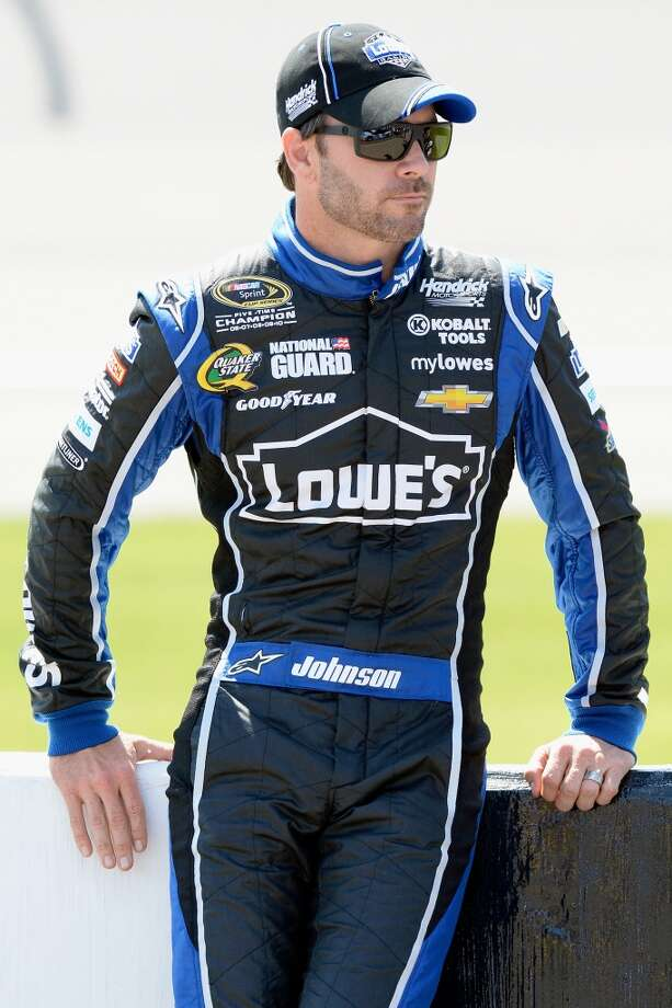 BROOKLYN, MI - JUNE 14:  Jimmie Johnson, driver of the #48 Lowe's Chevrolet, stands on the grid during qualifying for the NASCAR Sprint Cup Series Quicken Loans 400 at Michigan International Speedway on June 14, 2013 in Brooklyn, Michigan.  (Photo by John Harrelson/Getty Images)