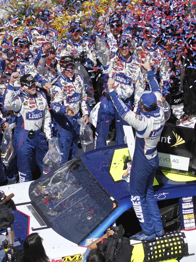 NASCAR driver Jimmie Johnson, foreground, and team members celebrate after he won the NASCAR Sprint Cup Series auto race Sunday, June 20, 2010, at Infineon Raceway in Sonoma, Calif.