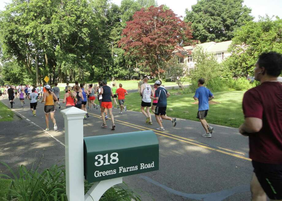 Many runners in the Stratton Faxon Fairfield Half Marathon said they enjoyed the new course, which included a stretch in Westport for the first time since 2001, incorporating a flatter stretch through the Greens Farms section of town and along Long Island Sound. Photo: Meg Barone / Westport News
