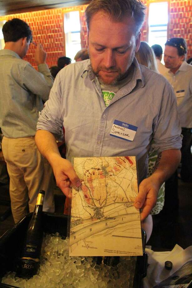 Andreas Spreitzer of Weingut Spreitzer shows a map of his family's vineyards along the Rhine-River in Germany. Their winery dates to 1641.