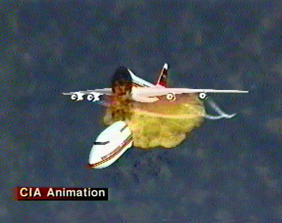 This file graphic image, provided by the Central Intelligence Agency, Dec. 9, 1997, shows an animation of the disintegration of Paris-bound TWA Flight 800 as it explodes off the coast of Long Island on July 17, 1996. The video was used to explain eyewitness accounts of the explosion, which killed all 230 people aboard. Former investigators on Wednesday, June 19, 2013 called on the National Transportation Safety Board to re-examine the cause, saying new evidence points to the often-discounted theory that a missile strike may have downed the jumbo jet. Photo: AP
