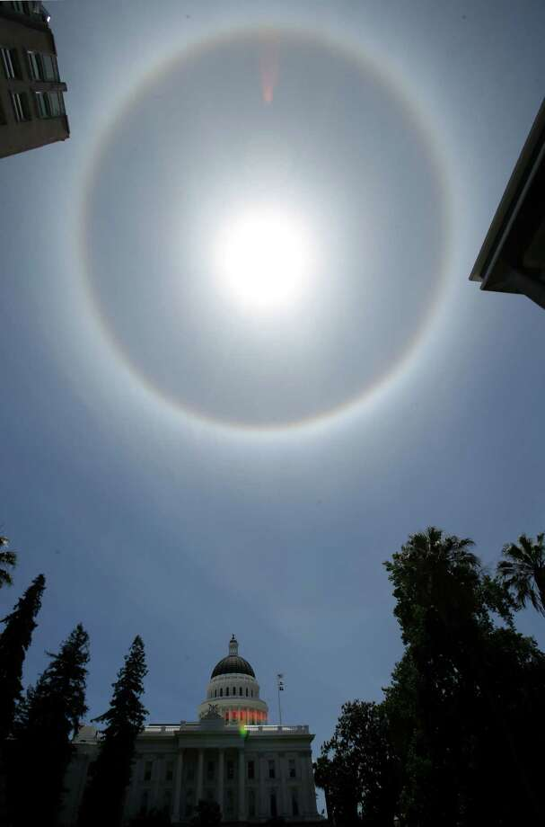 A halo around the sun is seen over the Capitol in Sacramento, Calif., Tuesday June 18, 2013. Known as a 22 degree halo, or a sun halo, it is caused by sunlight passing through ice crystals in cirrus clouds within the Earth's atmosphere, according to Darren Van Cleave, a meteorologist for the National Weather Service in Sacramento. Photo: AP