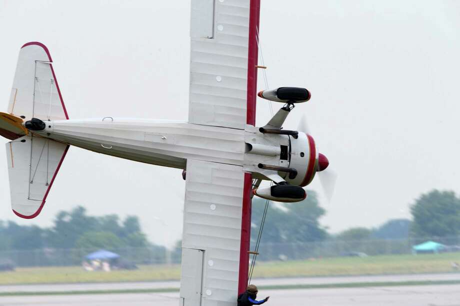 A stunt plane loses control as a wing walker performs at the Vectren Air Show just before crashing, Saturday, June 22, 2013, in Dayton, Ohio. The crash killed the pilot and the stunt walker instantly, authorities said. Photo: AP