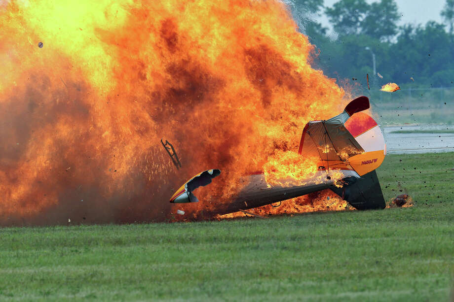 Flames erupt from a stunt plane after it crashed during a wing walker's performance at the Vectren Air Show, Saturday, June 22, 2013, in Dayton, Ohio. The crash killed the pilot and the wing walker instantly, authorities said. (AP Photo/Thanh V Tran) Photo: AP