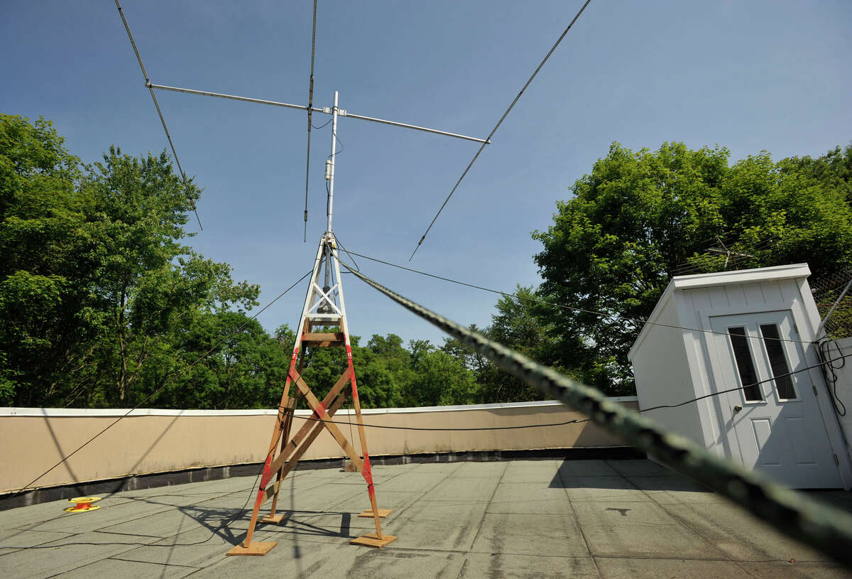 A radio antenna sits atop the observatory during the Stamford Amateur Radio Association's field day at the Stamford Museum & Nature Center on Sunday, June 23, 2013. The 24-hour field day is observed by ham radio operators accross the country and Canada to test their communications ability while working off of the electric grid